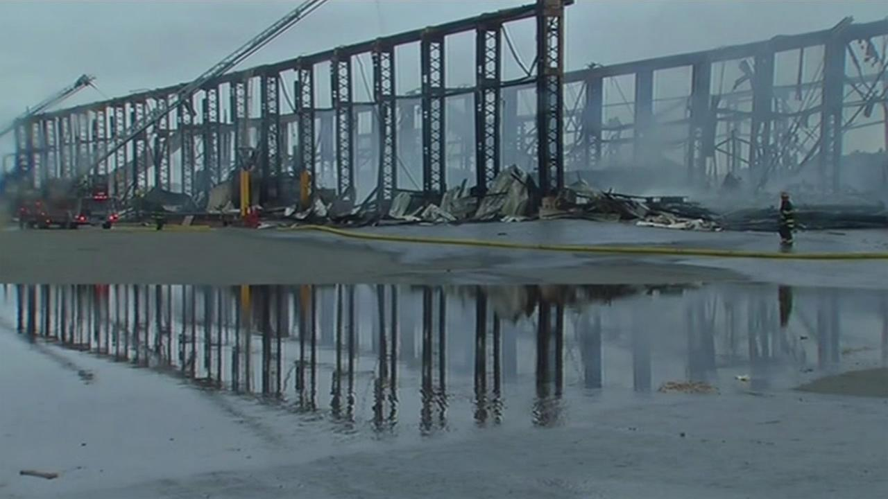 Firefighters battled a three-alarm warehouse fire at the Alco Metal and Iron Company on Mare Island in Vallejo, Calif. on Friday, August 21, 2015.