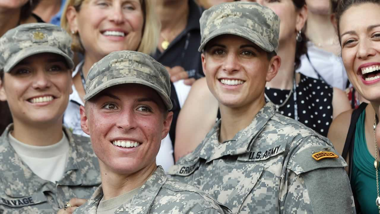 U.S. Army First Lt. Shaye Haver, center, and Capt. Kristen Griest, right, pose with other West Point alumni after an Army Ranger school graduation ceremony, Friday, Aug. 21, 2015.