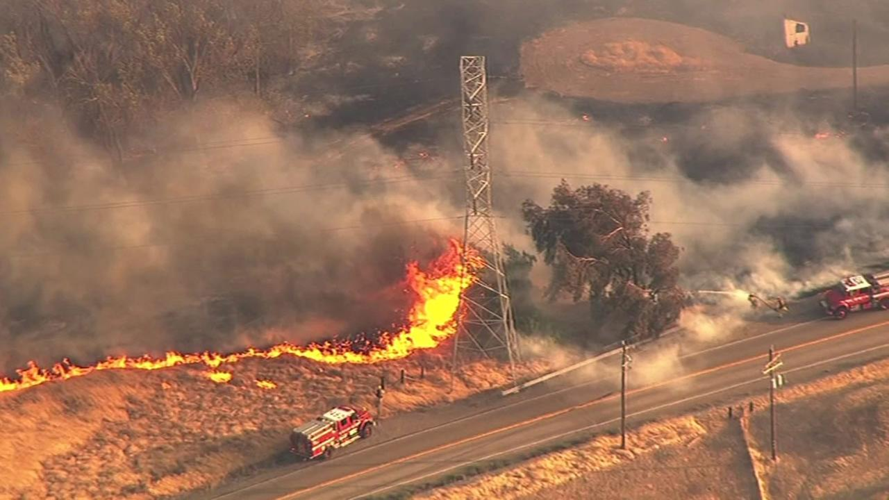 Crews continue to battle a grass fire that has burned 2,500 acres in Alameda County east of Livermore, Calif. on Friday, Aug. 21, 2015.