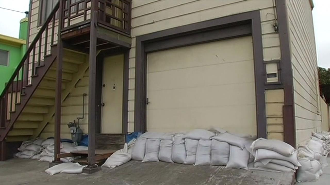 A home in a San Francisco neighborhood that flooded in Dec. 2014 still has sandbags after it repeatedly flooded and suffered damge, August 21, 2014.