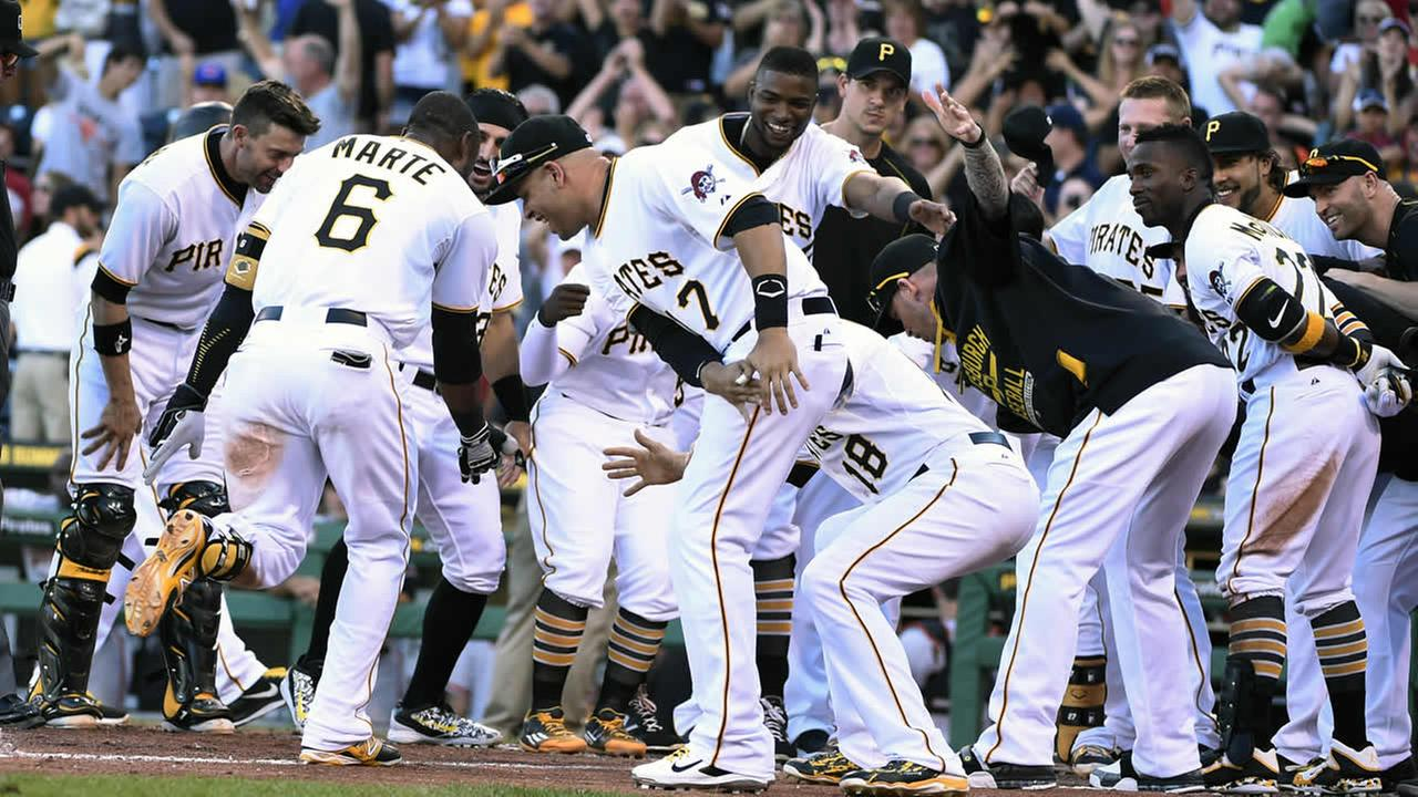 Pittsburgh Pirates Marte (6) is greeted by his teammates after hitting a game-winning home run off of Giants pitcher Kontos Saturday, Aug. 22, 2015, in Pittsburgh.