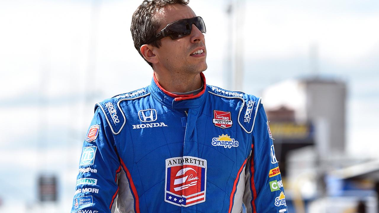 Justin Wilson, of England, walks on pit road during qualifying for Sundays Pocono IndyCar 500 auto race, Saturday, Aug. 22, 2015, in Long Pond, Pa. (AP Photo/Derik Hamilton)