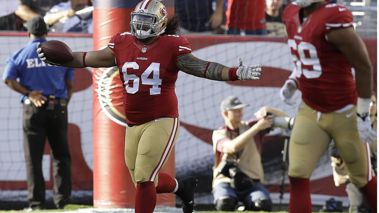 49ers nose tackle Mike Purcell celebrates after returning an interception for a touchdown against the Cowboys during a game in Santa Clara, Calif. on  Aug. 23, 2015. (AP Photo)