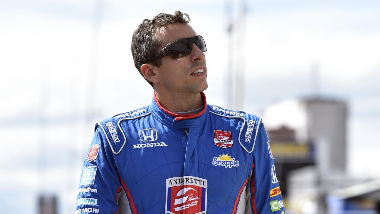This Aug. 22, 2015, file photo shows Justin Wilson, of England, walking on pit road during qualifying for Sundays Pocono IndyCar 500 auto race.