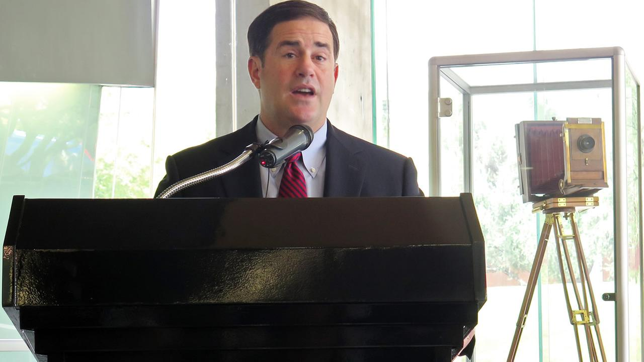 Arizona Gov. Doug Ducey talks about a new partnership between the San Francisco-based Uber and the University of Arizona, Tuesday, Aug. 25, 2015, in Tucson, Ariz.
