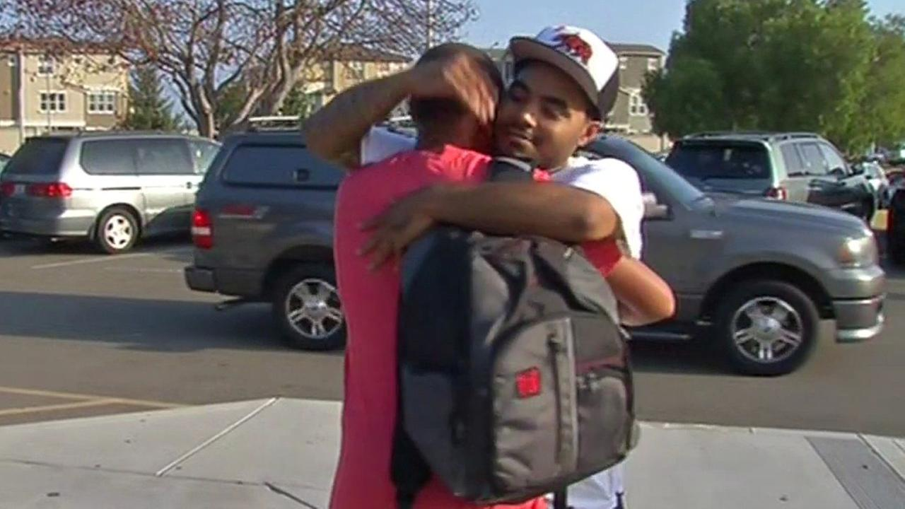 Dad hugs son at school in Hayward, Wednesday, August 26, 2015.