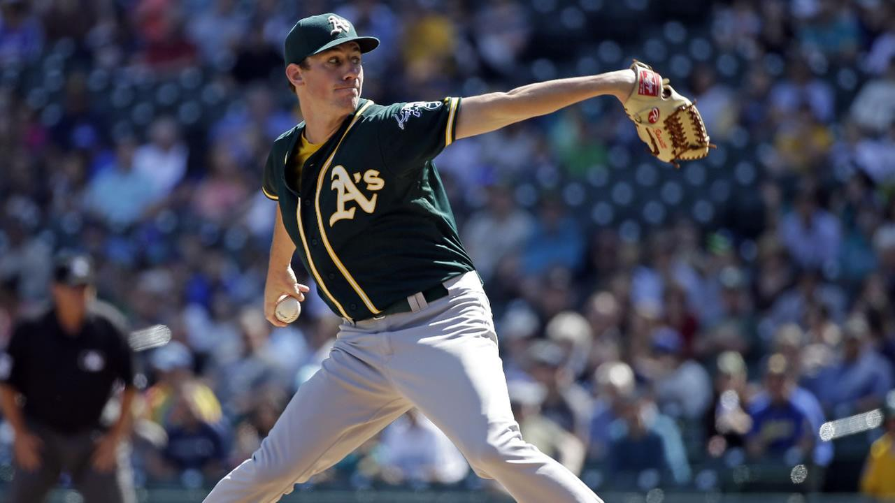 Oakland Athletics starting pitcher Chris Bassitt throws against the Seattle Mariners in the first inning of a baseball game Wednesday, Aug. 26, 2015, in Seattle.