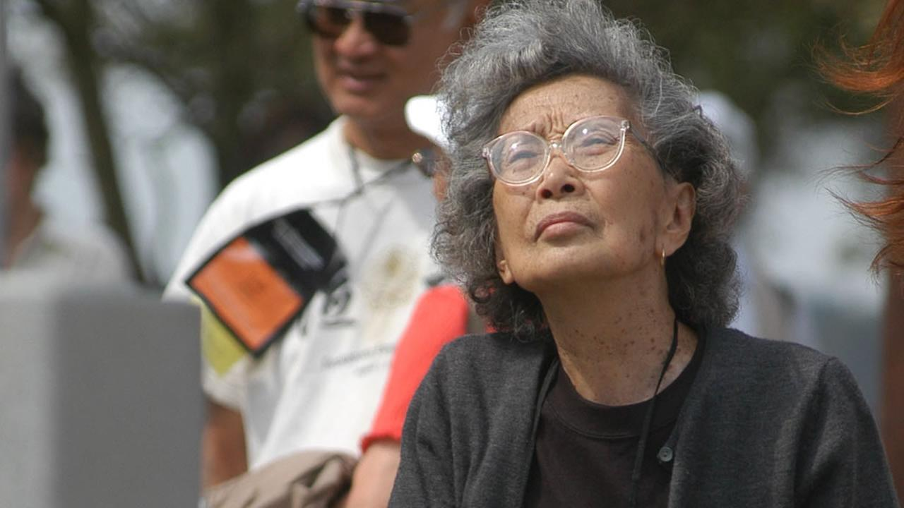 Yuri Kochiyama looks at a memorial erected for the inhabitants of a Japanese-American World War II internment camp, in Rohwer, Ark., Sept. 26, 2004. (AP Photo/Mike Wintroath)