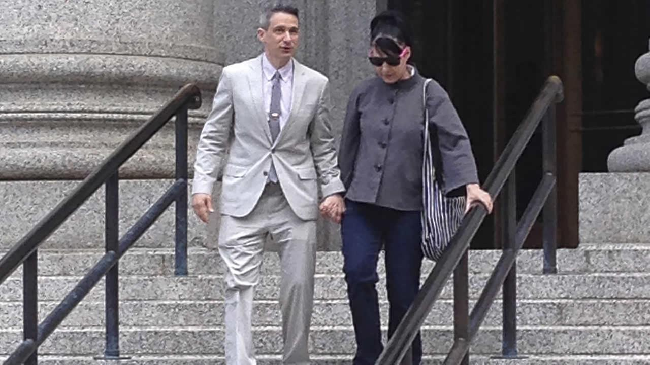 Beastie Boys rapper Adam Ad-Rock Horovitz leaves federal court in Manhattan with his wife after testifying at a copyright trial in New York. (AP Photo/Larry Neumeister)