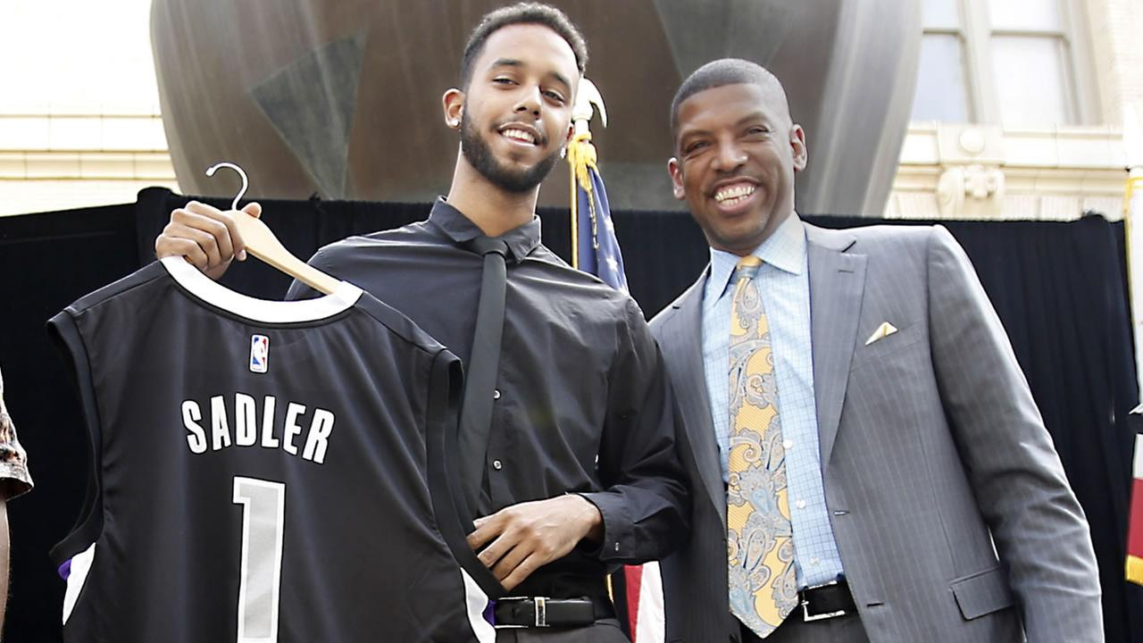 Anthony Sadler displays a Sacramento Kings jersey with his name and number presented to him by Mayor Kevin Johnson at a news conference Aug. 25 in Sacramento, Cali