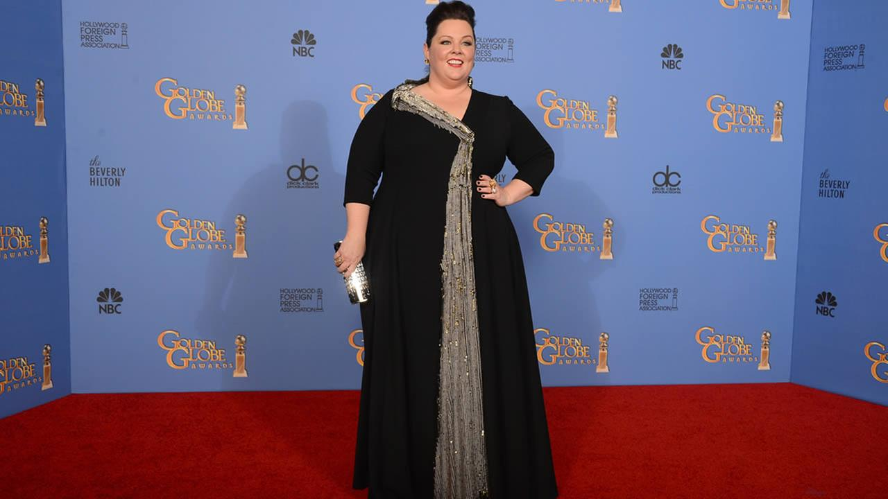 Melissa McCarthy poses in the press room at the 71st annual Golden Globe Awards, Jan. 12, 2014, in Beverly Hills, Calif. (Photo by Jordan Strauss/Invision/AP)