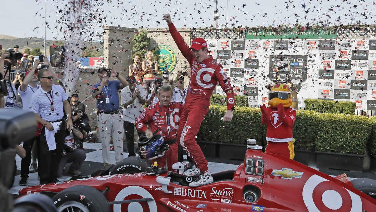Scott Dixon, of New Zealand, celebrates atop his car after winning the IndyCar Grand Prix of Sonoma auto race and IndyCar championship on Aug. 30, 2015, in Sonoma, Calif. (AP Photo