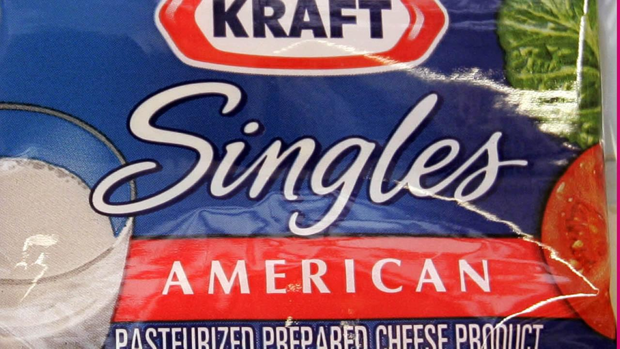 FILE - This Feb. 2, 2014 file photo shows Kraft Singles product on display at a market in Palo Alto, Calif.