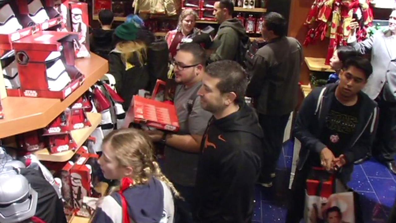 Shoppers grab the hottest Star Wars on Force Friday, September 4, 2015.