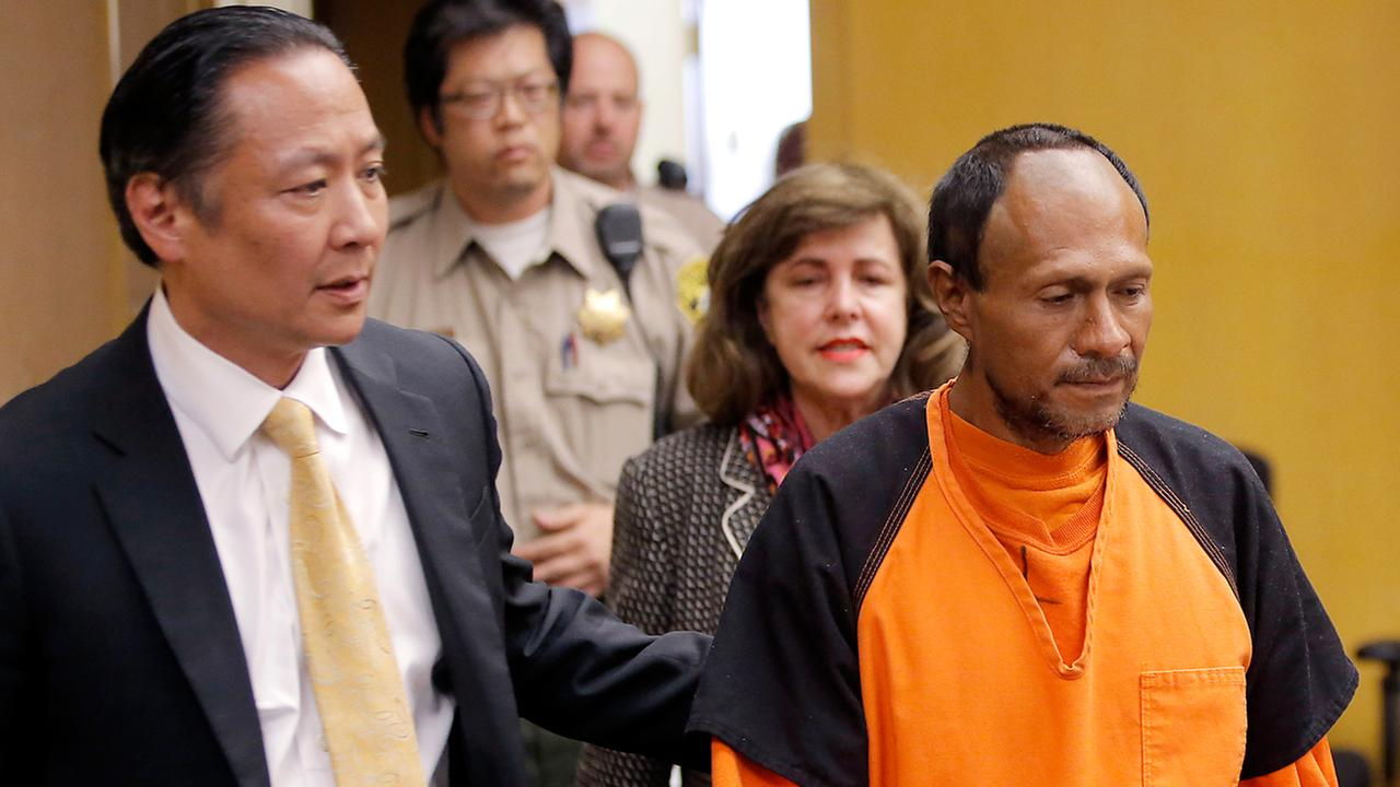 FILE - In this July 7, 2015 file photo, Juan Francisco Lopez-Sanchez, right, is lead into the courtroom by San Francisco Public Defender Jeff Adachi.