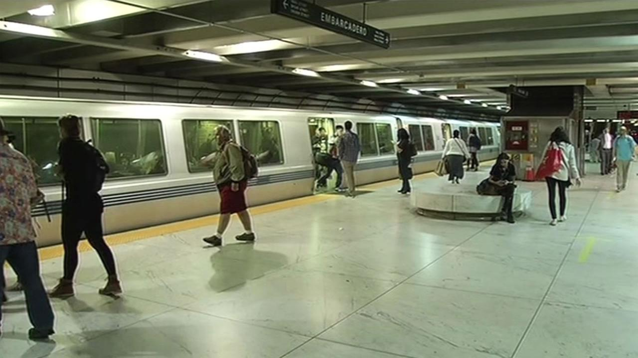 This undated photo shows commuters boarding a BART train at Embarcadero Station in San Francisco, California.