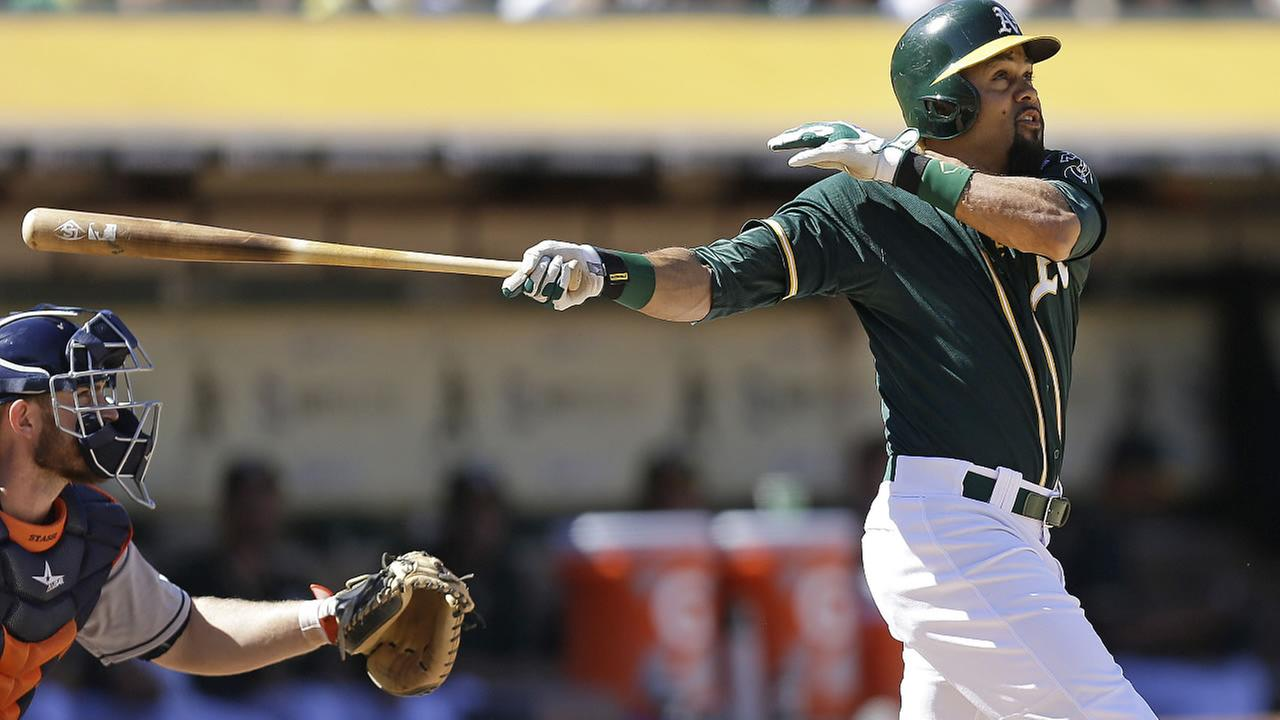 Athletics Coco Crisp swings for a two-run double off Astros Josh Fields in the sixth inning of a baseball game Monday, Sept. 7, 2015, in Oakland, Calif. (AP Photo/Ben Margot)
