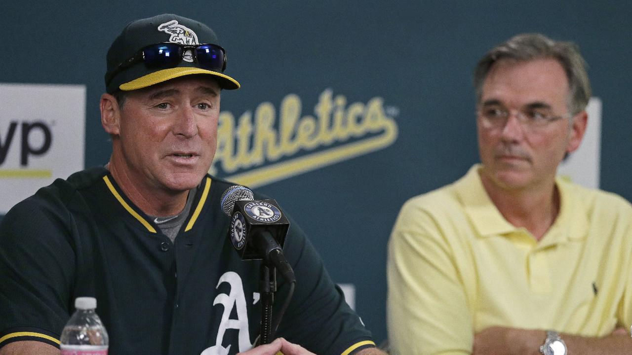 Oakland Athletics manager Bob Melvin, left, speaks beside general manager Billy Beane during a media conference Wednesday, Sept. 9, 2015, in Oakland, Calif.