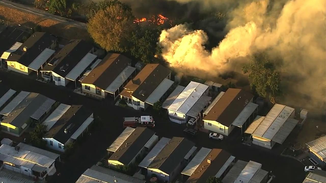 Crews battled a fast-moving grass fire that started burning next to a mobile home park in San Jose, Calif. on Wednesday, September 9, 2015.KGO-TV