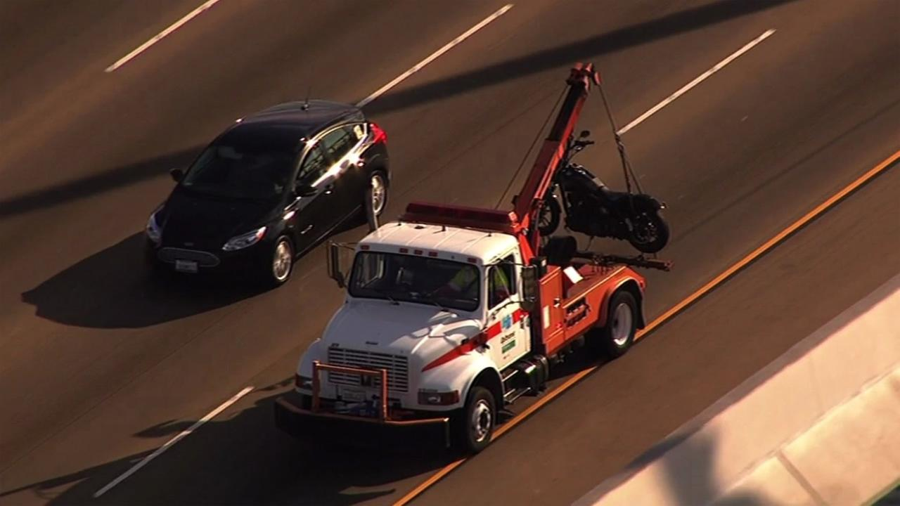 A tow truck carried off a motorcycle following an injury accident on the Bay Bridge on Thursday, September 10, 2015.