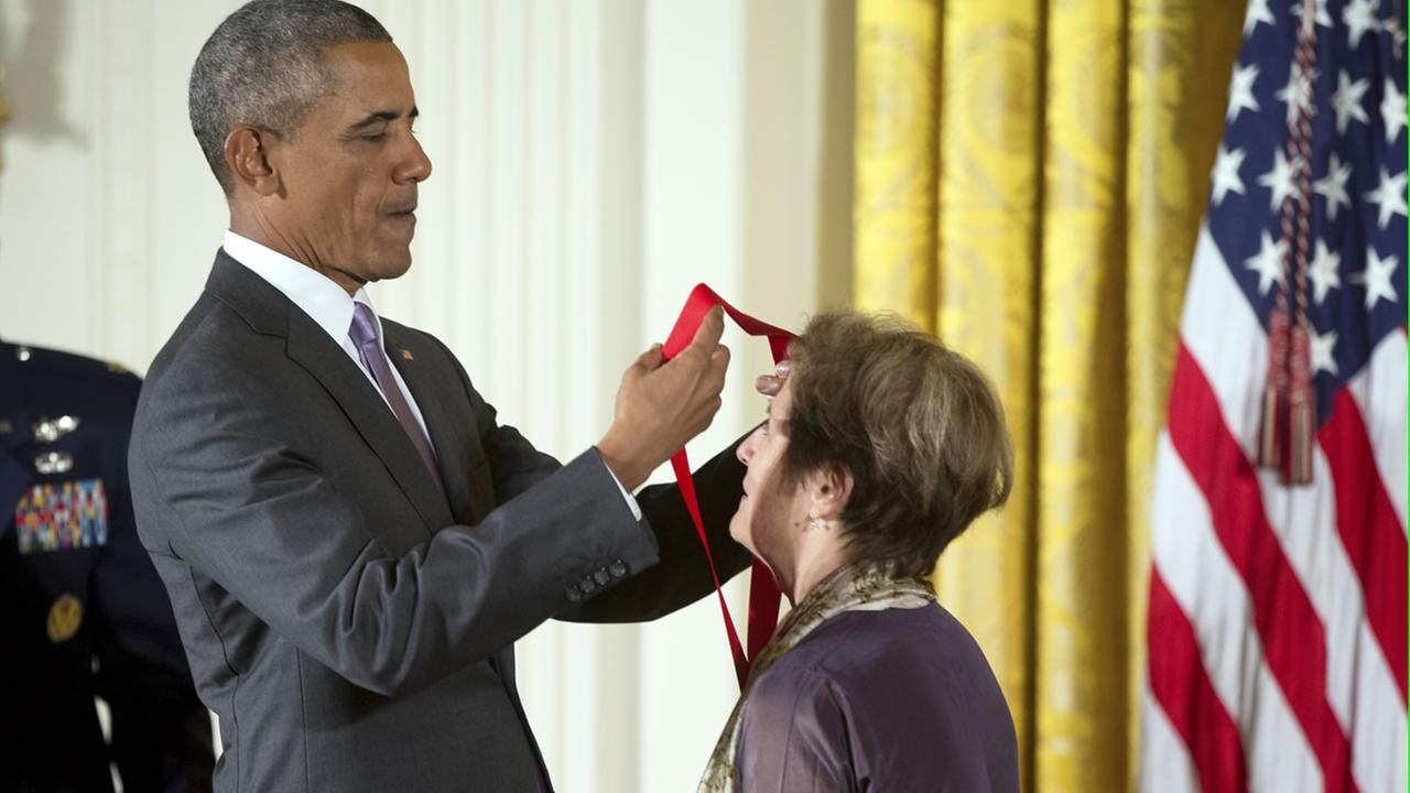 President Barack Obama awards the 2014 National Humanities Medal to chef, author, and advocate Alice Waters of Berkeley, Calif., during a ceremony at the White House in Washington.