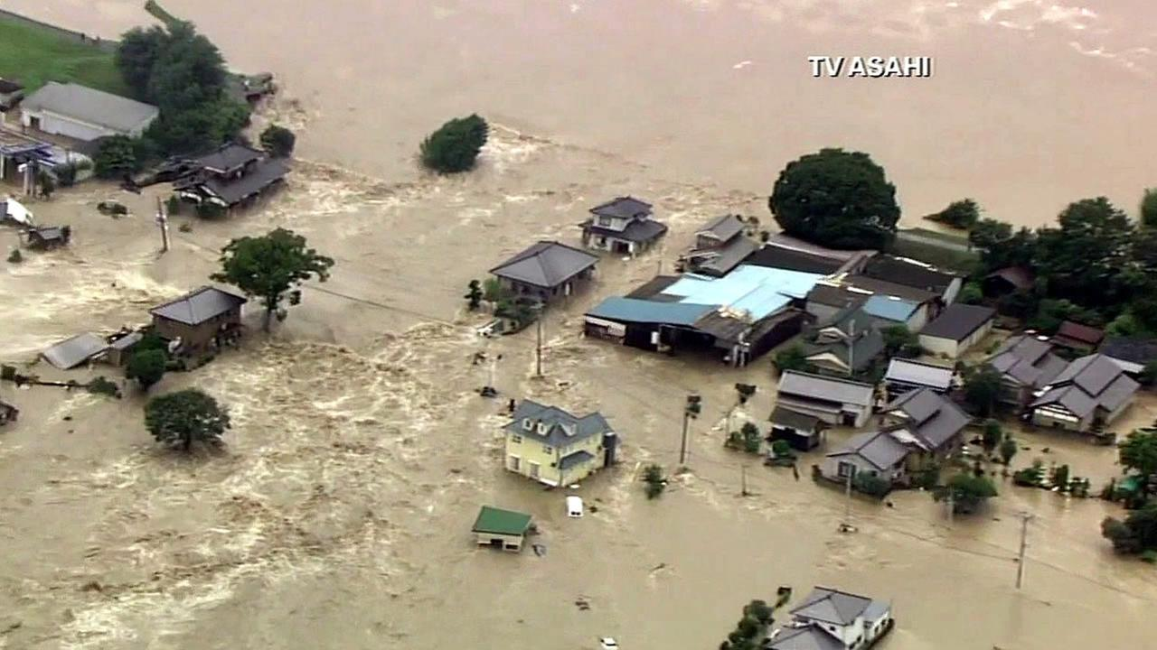 Rescue crews in Japan are scrambling to help hundreds of people stranded by widespread flooding.