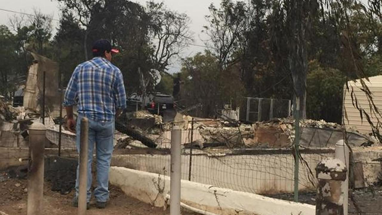 A Middletown resident surveys the damage done to his neighborhood and to his home, which is no longer standing, Monday, September 14, 2015.KGO-TV