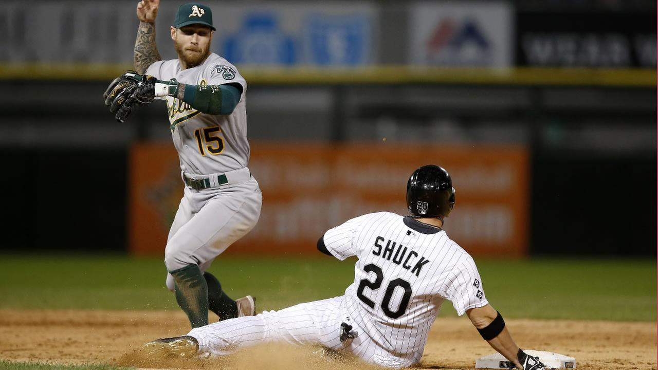Athletics Brett Lawrie (15) loses the ball after forcing out White Soxs J.B. Shuck (20) during the ninth inning of a baseball game Monday, Sept. 14, 2015, in Chicago. (AP Photo)