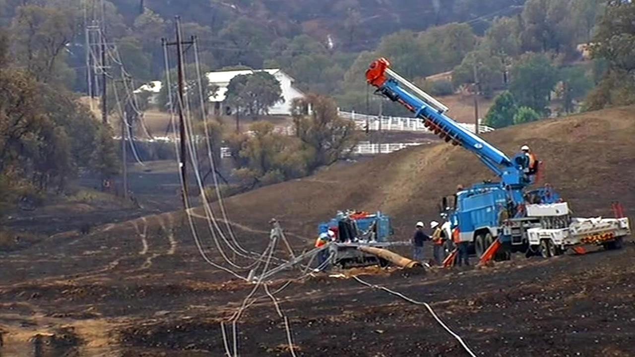 Crews cleared downed power lines and downed trees in Lake County, Calif. on Tuesday, September 15, 2015 after the Valley Fire tore through the area.KGO-TV