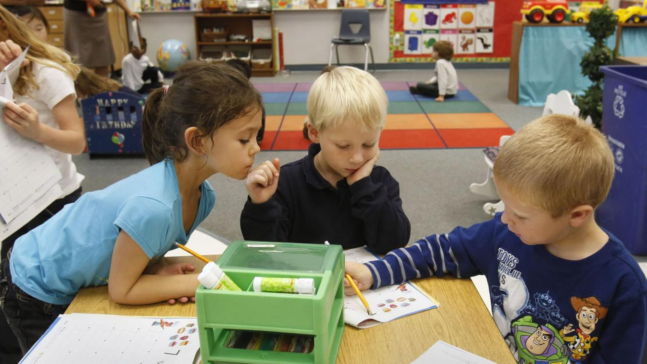 indergartners Isabella Fernandez, left, Mason Crawford, Jr., center, and Austin Welter, do a work sheet together at the Stone Lake Elementary School Elk Grove, Calif.