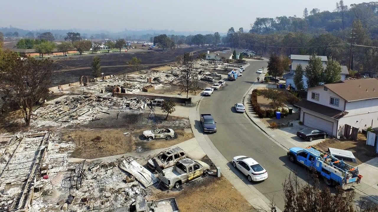This image taken with a drone shows a street in Middletown, Calif., where several homes were completely destroyed by the Lake County wildfire, Tuesday, Sept. 15, 2015. (AP Photo/Brian Skoloff)
