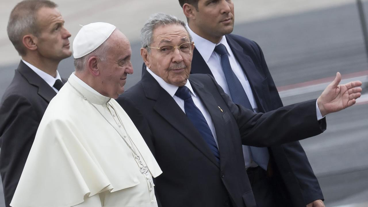Cubas President Raul Castro escorts Pope Francis during the popes arrival ceremony at the airport in Havana, Cuba, Saturday, Sept. 19, 2015. AP Photo/Ramon Espinosa