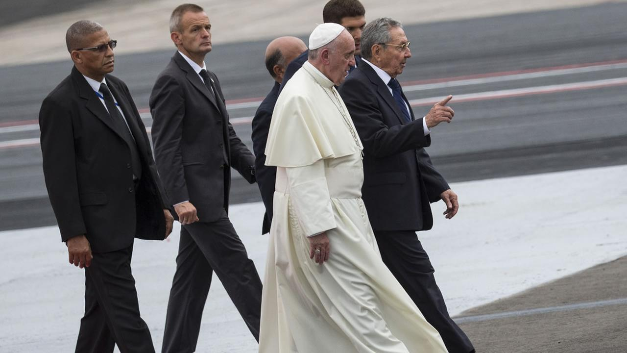 Cubas President Raul Castro, right, escorts Pope Francis during the popes arrival ceremony at the airport in Havana, Cuba, Saturday, Sept. 19, 2015. AP Photo/Ramon Espinosa