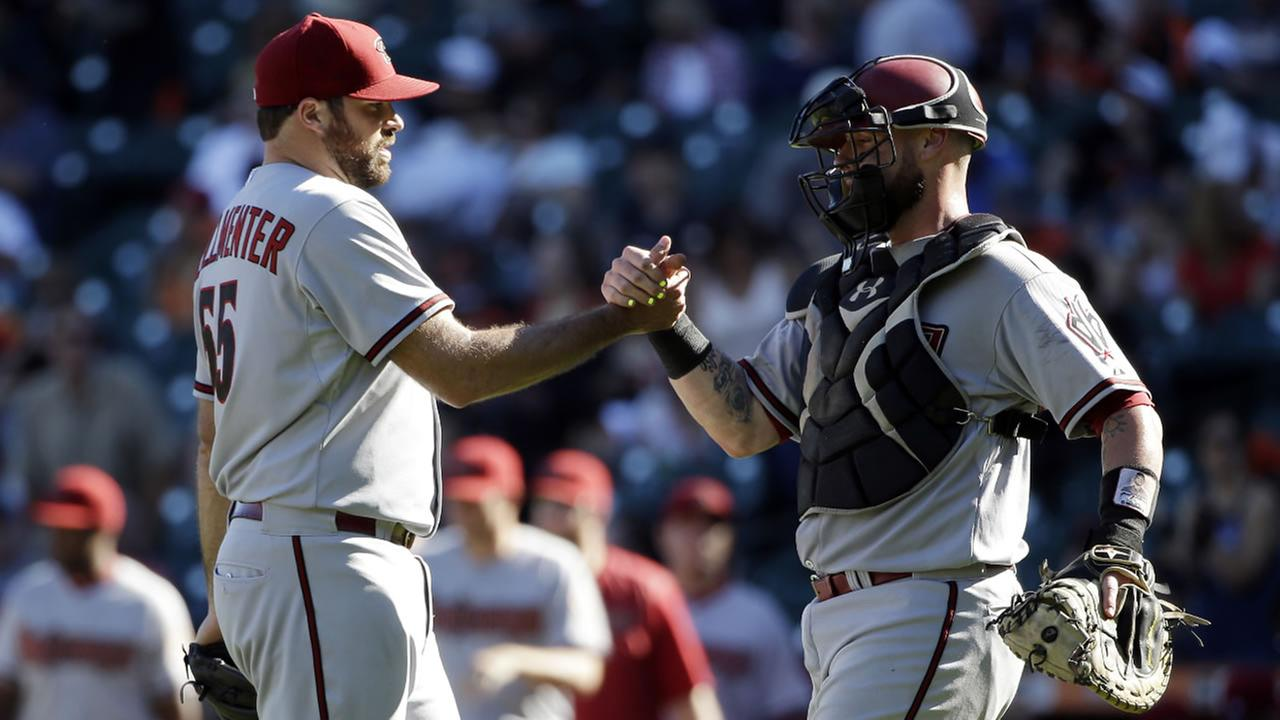 Diamondbacks relief pitcher Josh Collmenter, left, celebrates with catcher Jarrod Saltalamacchia after a 6-0 win over the Giants on Saturday, Sept. 19, 2015, in San Francisco.
