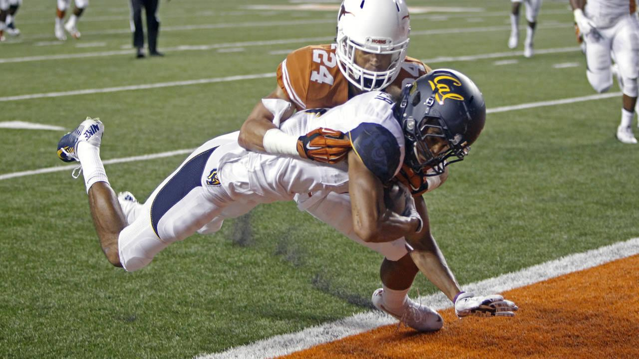California receiver Kenny Lawler falls into the end zone with a touchdown pass against Texas defensive back John Bonny (24) on Saturday, Sept. 19, 2015, in Austin, Texas.