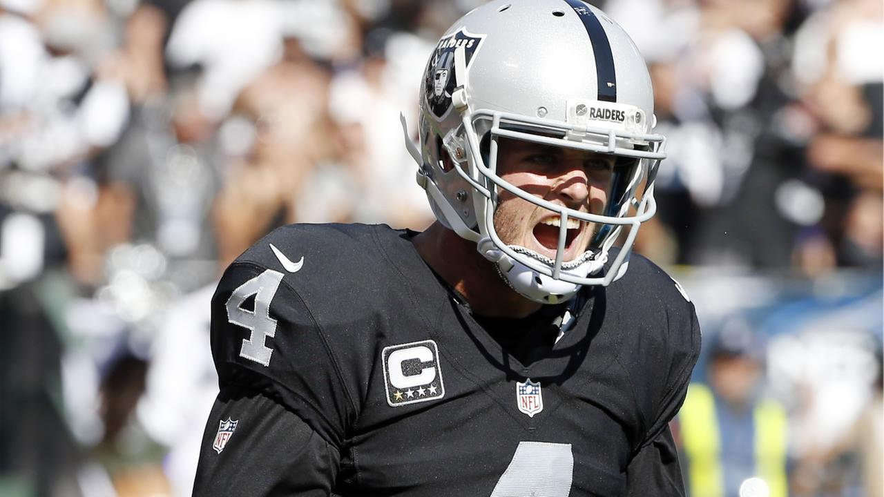 Raiders quarterback Derek Carr celebrates after throwing a touchdown pass to Michael Crabtree during an NFL football game Sunday, Sept. 20, 2015, in Oakland,  Calif. (AP Photo)