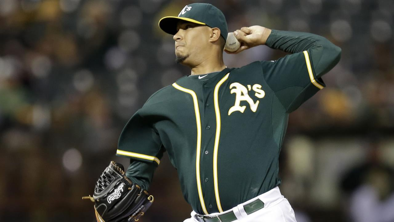 Oakland Athletics pitcher Felix Doubront works against the Texas Rangers during the first inning of a baseball game Wednesday, Sept. 23, 2015, in Oakland, Calif.