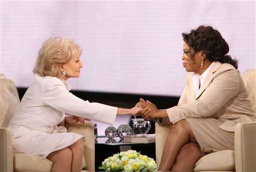 In this image released by Harpo Productions, journalist Barbara Walters, left, holds the hand of Oprah Winfrey during an interview for &#34;The Oprah Winfrey Show,&#34; in April 2008. <span class=meta>AP Photo/George Burns</span>