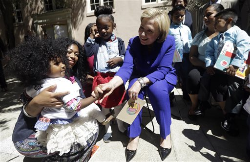<div class='meta'><div class='origin-logo' data-origin='none'></div><span class='caption-text' data-credit='AP Photo'>Hillary Clinton shakes hands with Xochi Johnson, 2, who is held by her mother Pilar Fisher at Children's Hospital Oakland Research Institute in Oakland on Wednesday, July 23, 2014.</span></div>