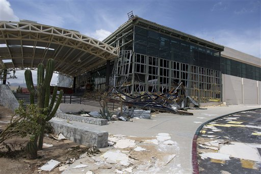 "<div class=""meta image-caption""><div class=""origin-logo origin-image ""><span></span></div><span class=""caption-text"">The main entrance to the airport sits heavily damaged after hurricane Odile roared past San Jose de los Cabos, Mexico, Wednesday, Sept. 17, 2014. (AP)</span></div>"