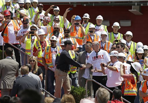 "<div class=""meta ""><span class=""caption-text "">San Francisco 49ers head coach Jim Harbaugh shakes hands with construction workers just before the ribbon-cutting and opening of Levi's Stadium. (AP Photo/Eric Risberg)</span></div>"