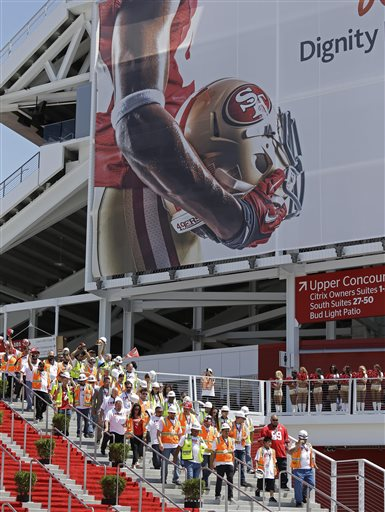 "<div class=""meta ""><span class=""caption-text "">Construction workers make their way to the ribbon-cutting and opening of Levi's Stadium Thursday, July 17, 2014, in Santa Clara, California. (AP Photo/Eric Risberg)</span></div>"