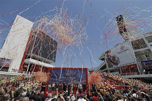 "<div class=""meta ""><span class=""caption-text "">Confetti rains down during the ribbon-cutting and opening of Levi's Stadium. (AP Photo/Eric Risberg)</span></div>"