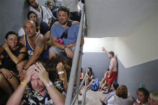 "<div class=""meta image-caption""><div class=""origin-logo origin-image ""><span></span></div><span class=""caption-text"">Tourists sit on the concrete stairs in the service area of a resort after the designated area for shelter was destroyed by winds in Los Cabos, Mexico, Monday, Sept. 15, 2014. (AP)</span></div>"