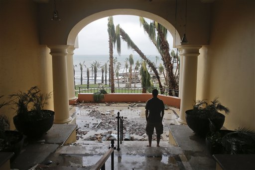 "<div class=""meta image-caption""><div class=""origin-logo origin-image ""><span></span></div><span class=""caption-text"">A tourists looks to the ocean from inside a debris-filled area at the Hilton hotel after the resort sustained severe damage from Hurricane Odile in Los Cabos, Mexico. (AP)</span></div>"