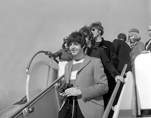 Paul McCartney, followed by Ringo Starr and John Lennon of the Beatles, arrive by plane at San Francisco International Airport on Aug. 29, 1966. <span class=meta></span>