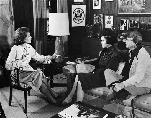 Jimmy Carter and his wife, Rosalynn, center, are interviewed by ABC-TV correspondent  Barbara Walters,left, in Plains in December 1976 in their Georgia, home. <span class=meta>(AP Photo)</span>