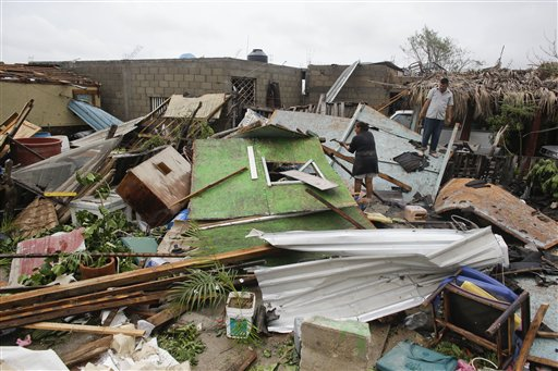 "<div class=""meta image-caption""><div class=""origin-logo origin-image ""><span></span></div><span class=""caption-text"">A family salvages goods from their house that was destroyed by Hurricane Odile in Los Cabos, Mexico, Monday, Sept. 15, 2014.  (AP)</span></div>"