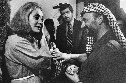 Palestinian leader Yasir Arafat presents Barbara Walters of ABC with a handmade dress and mother- of-pearl box following an interview with him in Beirut, Sept. 21 1977. <span class=meta>AP Photo/Harry Koundakjian</span>