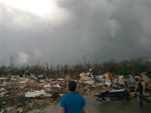 """<div class=""""meta image-caption""""><div class=""""origin-logo origin-image """"><span></span></div><span class=""""caption-text"""">This photo provided by James Bryant shows tornado damage, Sunday, April 27, 2014 in Mayflower, Ark. A powerful storm system rumbled through the central and southern United States on Sunday, spawning several tornadoes, including one that killed two people in a small northeastern Oklahoma city and another that carved a path of destruction through several northern suburbs of Little Rock, Ark. (AP Photo/Courtesy of James Bryant) </span></div>"""